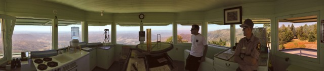 Panoramic view from inside the lookout.  Brother on left, fire lookout volunteer on right.  Click for much larger.