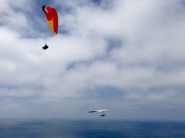 Hang glider below a paraglider.
