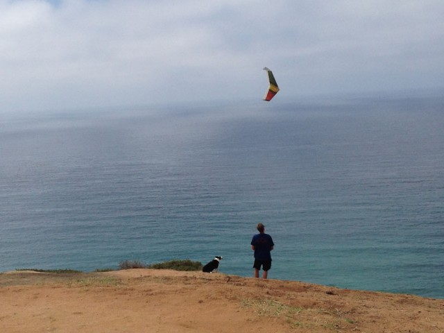 A man flying his radio controlled glider.